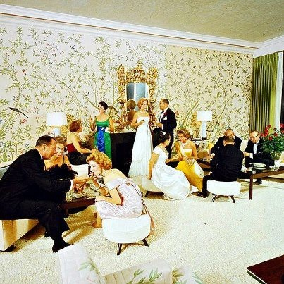 New Year's Dinner party at Alfred and Betsy Bloomingdale's home in Holmby Hills, photo by Nat Farbman, 1959. And what are the ladies are wearing? From top to bottom Clockwise; black evening gown by Pierre